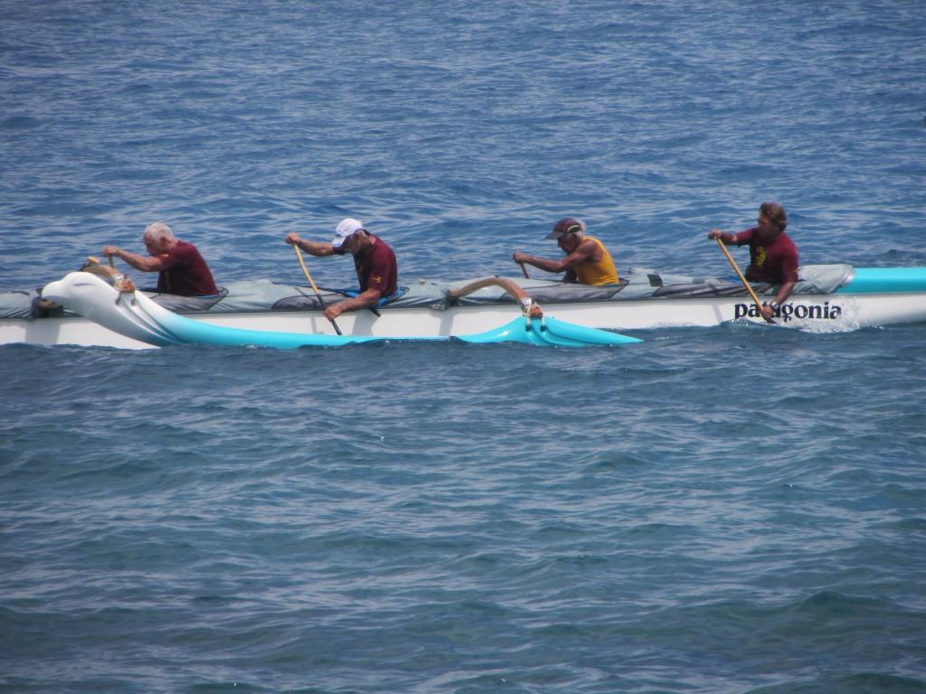 The Keauhou Kupuna Boys, with Rafael Ramirez in yellow, approach the finish line at Kamakahonu Beach in Kailua-Kona.