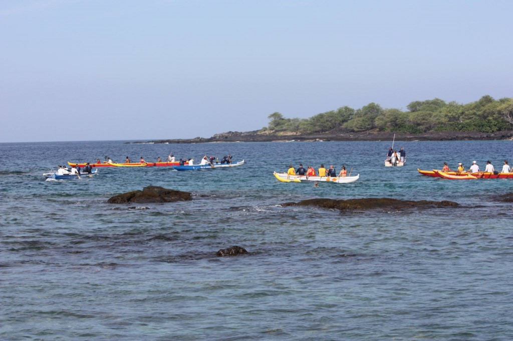 Canoes from Miloli'i and Keoua Canoe clubs meet at Ho'okena
